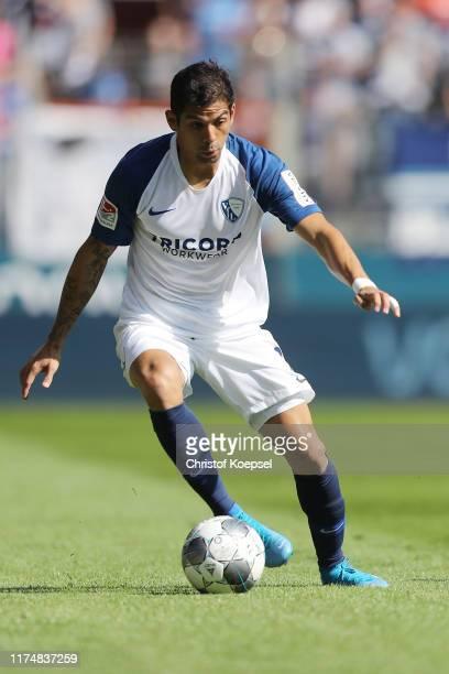 Cristian Gamboa of Bochum runs with the ball during the Second Bundesliga match between VfL Bochum 1848 and SG Dynamo Dresden at Vonovia Ruhrstadion...