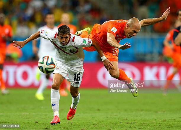 Cristian Gamboa of Costa Rica and Arjen Robben of the Netherlands compete for the ball during the 2014 FIFA World Cup Brazil Quarter Final match...