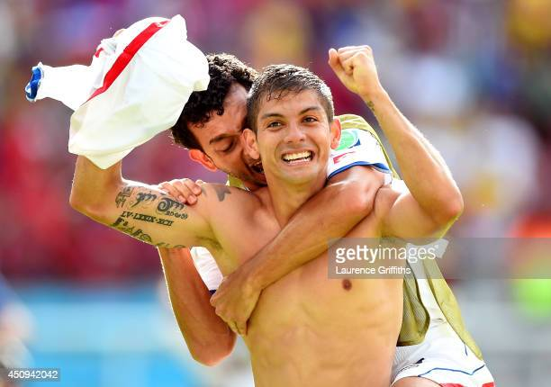 Cristian Gamboa of Costa Rica celebrates with Michael Barrantes after defeating Italy 1-0 during the 2014 FIFA World Cup Brazil Group D match between...