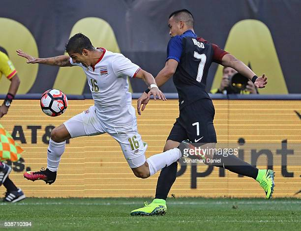 Cristian Gamboa of Costa Rica chases down the ball in front of Bobby Wood of United States during a match in the 2016 Copa America Centenario at...