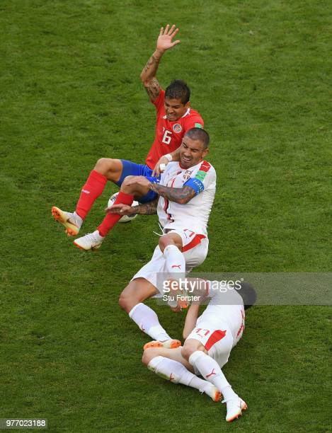 Cristian Gamboa of Costa Rica is challenged by Aleksander Kolarov and Fiilip Kostic of Serbia during the 2018 FIFA World Cup Russia group E match...