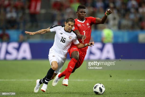Cristian Gamboa of Costa Rica is challenged by Breel Embolo of Switzerland during the 2018 FIFA World Cup Russia group E match between Switzerland...