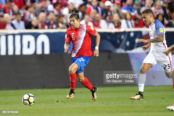 Cristian Gamboa of Costa Rica is challenged by Fabian Johnson of the United States during the United States Vs Costa Rica CONCACAF International...