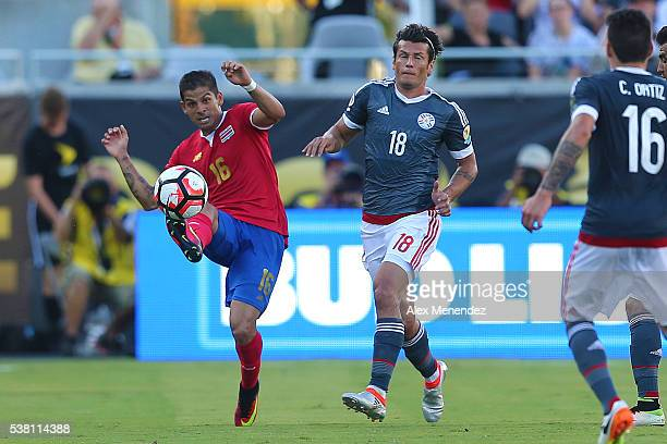 Cristian Gamboa of Costa Rica kicks the ball in front of Nelson Haedo Valdez of Paraguay during the 2016 Copa America Centenario Group A match...