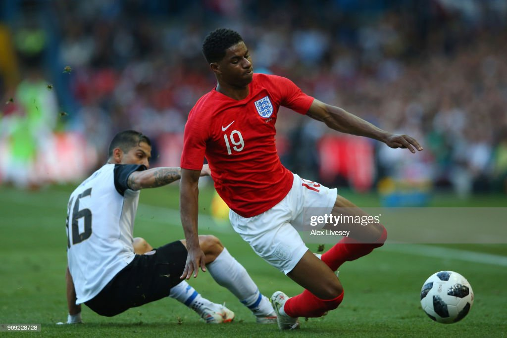 Cristian Gamboa of Costa Rica tackles Marcus Rashford of England during the International Friendly match between England and Costa Rica at Elland Road on June 7, 2018 in Leeds, England.