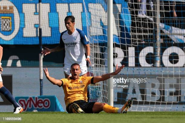 Cristian Gamboa of VfL Bochum and Rene Klingenburg of Dynamo Dresden gesture during the Second Bundesliga match between VfL Bochum 1848 and SG Dynamo...