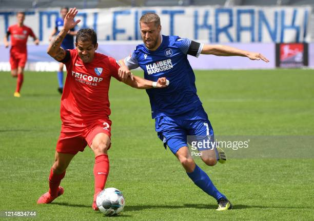 Cristian Gamboa of VfL Bochum battles for possession with Marc Lorenz of Karlsruher SC during the Second Bundesliga match between Karlsruher SC and...