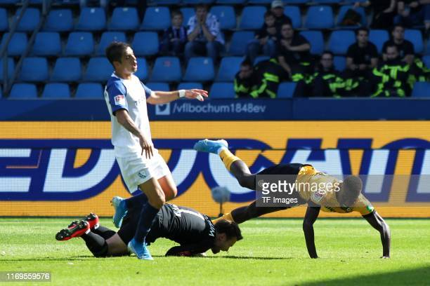 Cristian Gamboa of VfL Bochum, Moussa Kone of Dynamo Dresden battle for the ball during the Second Bundesliga match between VfL Bochum 1848 and SG...