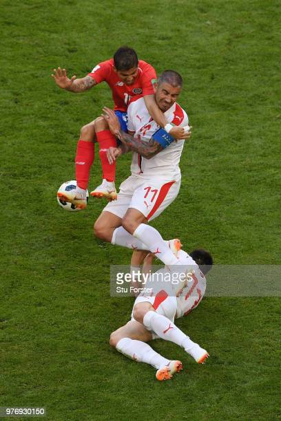 Cristian Gamboa or Costa Rica is challenged by Aleksandar Kolarov and Filip Kostic of Serbia during the 2018 FIFA World Cup Russia group E match...