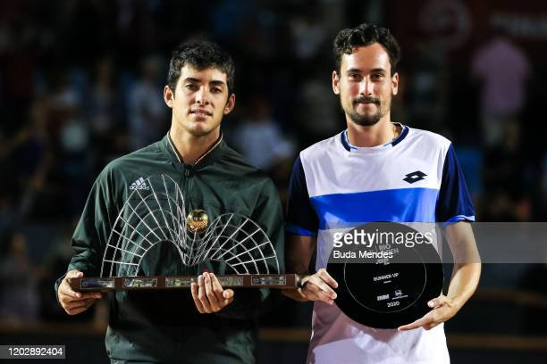 Cristian Garin of Chile and Gianluca Mager of Italy pose on the podium after the singles final of the ATP Rio Open the men's singles final match at...