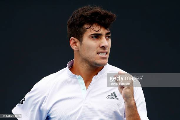 Cristian Garin of Chile celebrates after winning a point during his Men's Singles first round match against Stefano Travaglia of Italy on day one of...