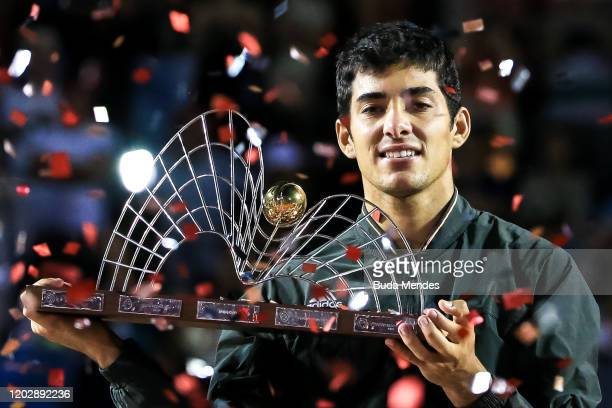 Cristian Garin of Chile celebrates with the trophy after defeating Gianluca Mager of Italy at the men's singles final match of the ATP Rio Open 2020...