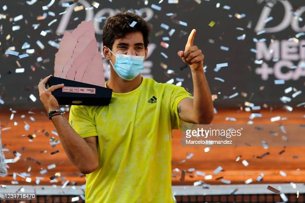Cristian Garin of Chile celebrates with the trophy after winning the match against Facundo Bagnis of Argentina during the final of Chile Dove...
