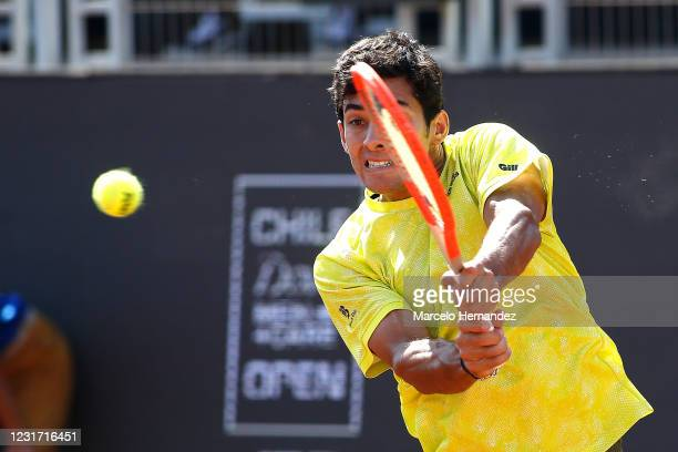 Cristian Garin of Chile plays a backhand against Facundo Bagnis of Argentina during the final of Chile Dove Men+Care Open at Club Deportivo...