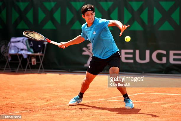 Cristian Garin of Chile plays a forehand during his mens singles first round match against Reilly Opelka of The United States during Day two of the...