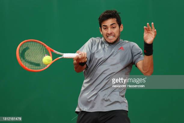 Cristian Garin of Chile plays a forehand in his Singles Match against Felix Auger Aliassime of Canada during the First Round of the Rolex Monte-Carlo...