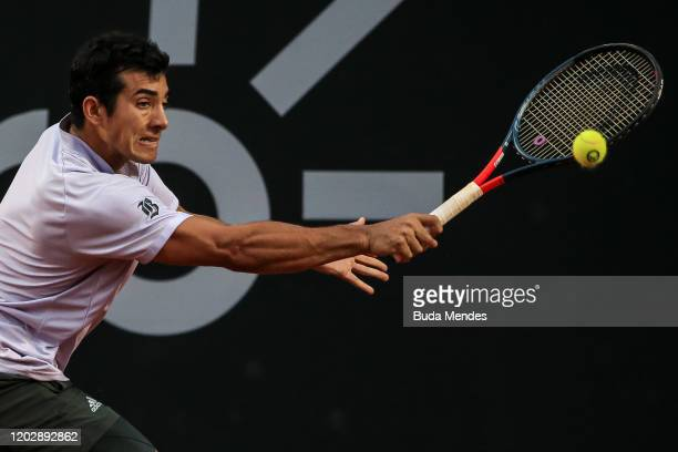Cristian Garin of Chile returns a shot to Gianluca Mager of Italy during the men's singles final match of the ATP Rio Open 2020 at Jockey Club...