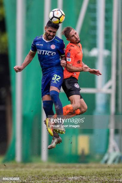 Cristian Gaston Caetano of BC Rangers fights for the ball with Carlos Augusto Bertoldi of Sun Bus Yeun Long during the Hong Kong Premier League Week...