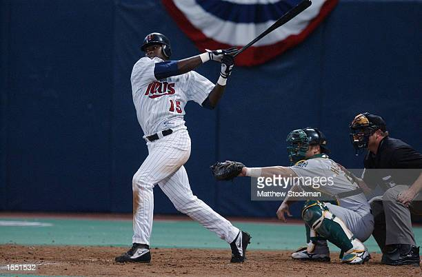 Cristian Guzman of the Minnesota Twins connects with the ball during the American League Division Series against the Oakland A's on October 4 2002 at...