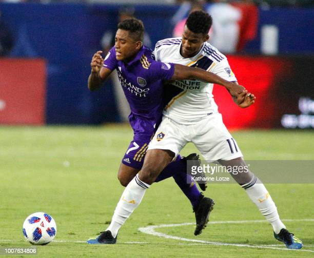 Cristian Higuita of Orlando City SC and Ola Kamara of the Los Angeles Galaxy fight for control of the ball at StubHub Center on July 29 2018 in...