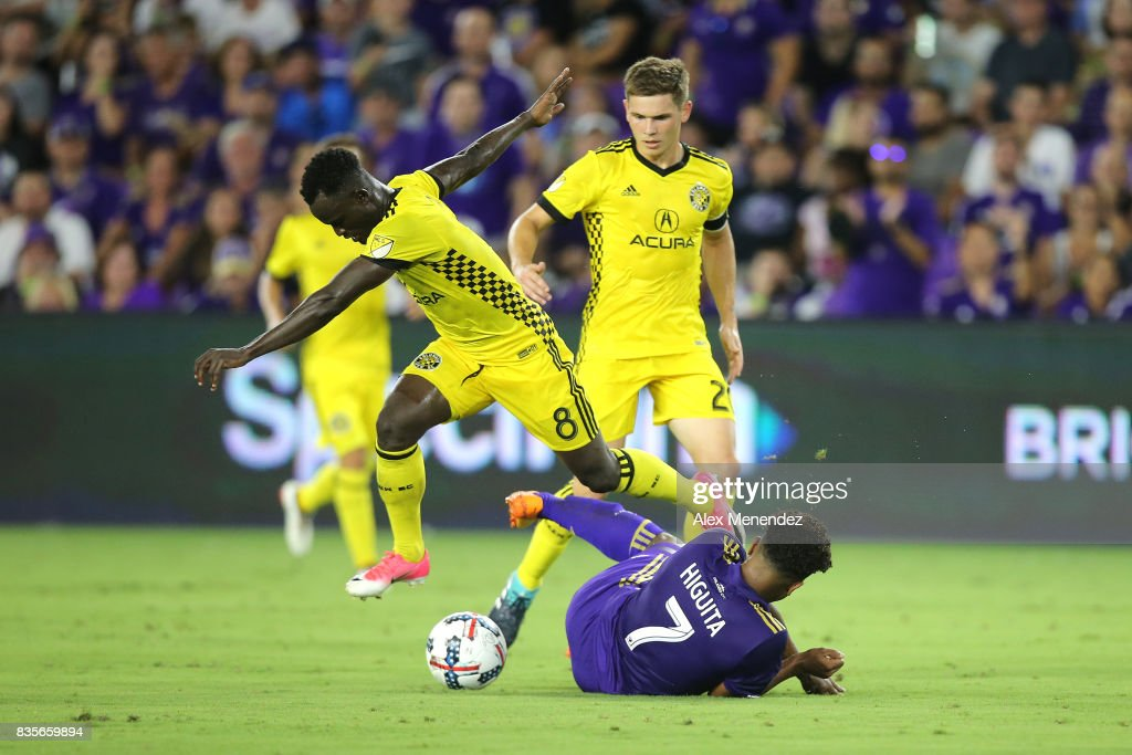 Cristian Higuita #7 of Orlando City SC gets fouled by Mohammed Abu #8 of Columbus Crew SC during a MLS soccer match between the Columbus Crew SC and the Orlando City SC at Orlando City Stadium on August 19, 2017 in Orlando, Florida.