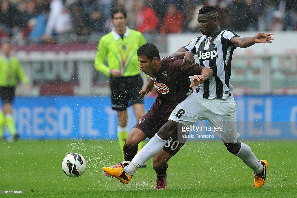 Cristian Jonathas (L) of Torino FC competes with Paul Pogba of Juventus during the Serie A match between Torino FC and Juventus at Stadio Olimpico di Torino on April 28, 2013 in Turin, Italy.