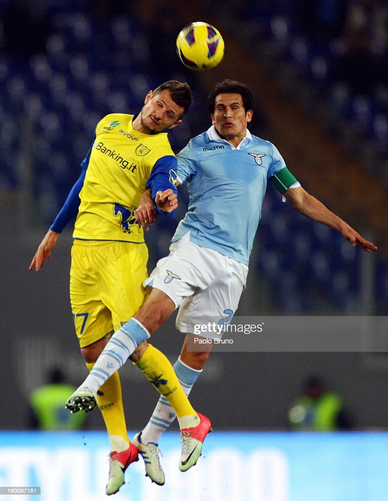 Cristian Ledesma (L) of S.S. Lazio competes for the ball with Cyril Thereau of AC Chievo during the Serie A match between S.S. Lazio and AC Chievo Verona at Stadio Olimpico on January 26, 2013 in Rome, Italy.