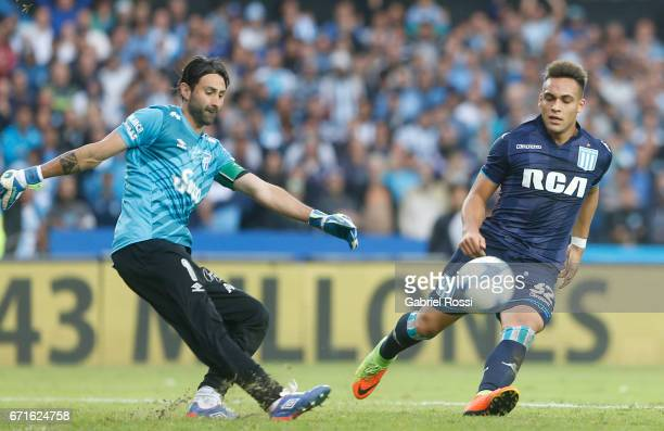 Cristian Lucchetti of Atletico de Tucuman fights for the ball with Lautaro Martinez of Racing Club during a match between Racing and Atletico de...