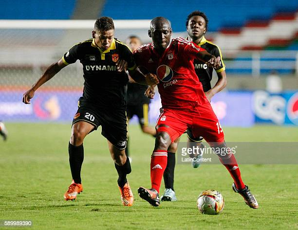 Cristian Martinez Borja of America de Cali fights for the ball with Oaldieir Morales of Bogota FC during a match between America de Cali and Bogota...