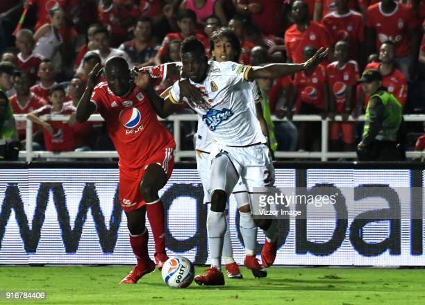 Cristian Martinez Borja of of America vies for the ball with Fainer Torijano of Deportes Tolima during a match between America de Cali and Deportes...