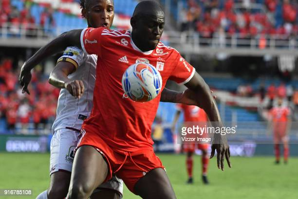 Cristian Martinez Borja of of America vies for the ball with Julián Alveiro Quiñones of Deportes Tolima during a match between America de Cali and...