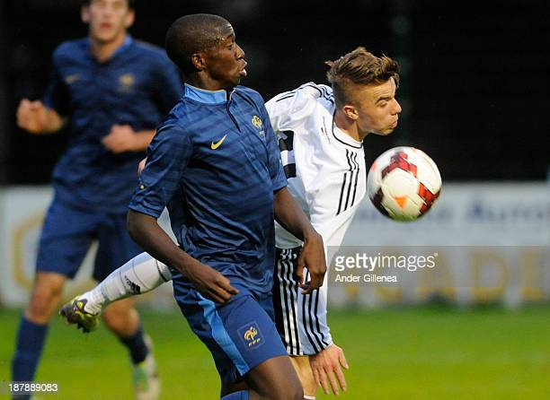 Cristian Mauersberger of Germany battles for the ball with Yarouba Cissano of France during a friendly match between U19 France and U19 Germany at...