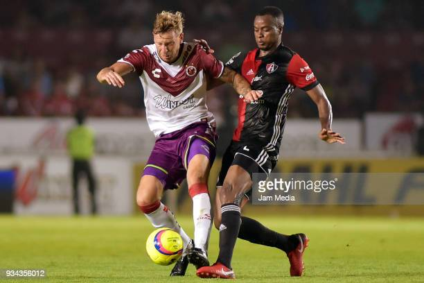Cristian Menendez of Veracruz and Jaine Barreiro of Atlas fight for the ball during the 12th round match between Veracruz and Atlas as part of the...