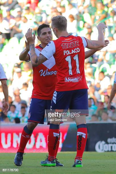 Cristian Menendez of Veracruz celebrates with teammate Adrian Luna after scoring the first goal of his team during the 4th round match between Santos...