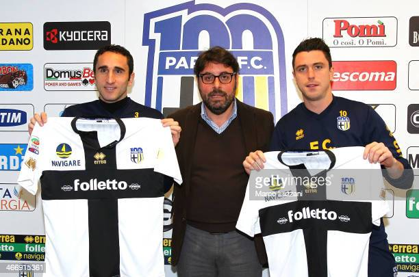 Cristian Molinaro and Nicola Pozzi , new signings for Parma FC pose with the club shirt with General Manager of Parma FC Pietro Leonardi during a...