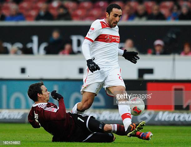 Cristian Molinaro of Stuttgart is challenged by Markus Feulner of Nuernberg during the Bundesliga match between VfB Stuttgart and 1 FC Nuernberg at...