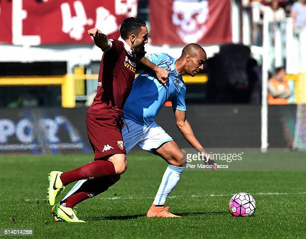 Cristian Molinaro of Torino FC competes for the ball with Abdoulay Konko of SS Lazio during the Serie A match between Torino FC and SS Lazio at...