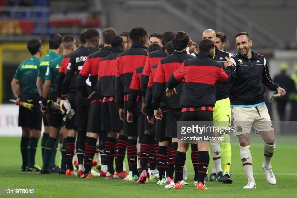 Cristian Molinaro of Venezia FC salutes Alessandro Florenzi of AC Milan as handshakes during the line up return to the match schedule during the...