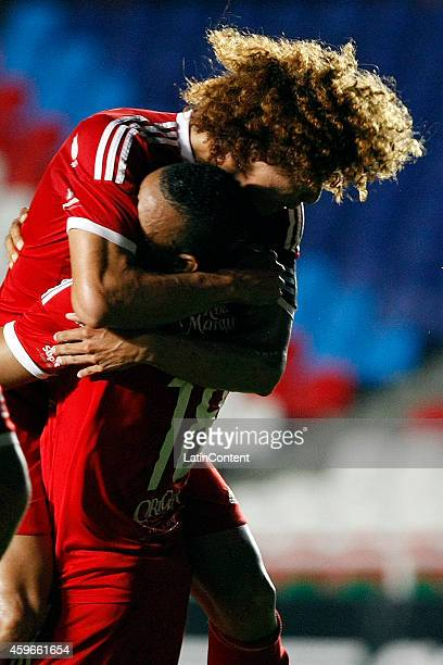 Cristian Montaño of America de Cali celebrates with Stiven Tapiero after scoring the opening goal during a match between America de Cali and Rionegro...