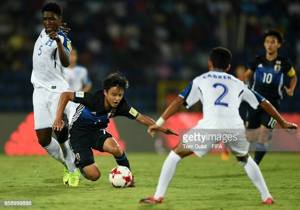 Cristian Moreira of Honduras and Takefusa Kubo of Japan battle for the ball during the FIFA U17 World Cup India 2017 group E match between Honduras...