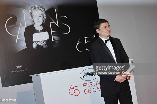 Cristian Mungiu poses at the Winners Photocall during the 65th Cannes International Film Festival