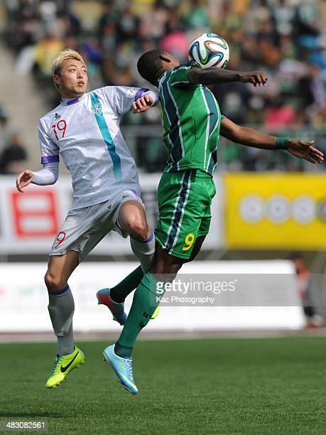Cristian Nazarit of FC Gifu and Shunsuke Tsutsumi of Avispa Fukuoka compete for the ball during the JLeague second division match between FC Gifu and...