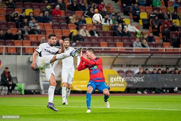 Cristian Oros of FC Astra Giurgiu and Milan Petrzela of FC Viktoria Plzen during the UEFA Europa League 20162017 Group E game between FC Astra...
