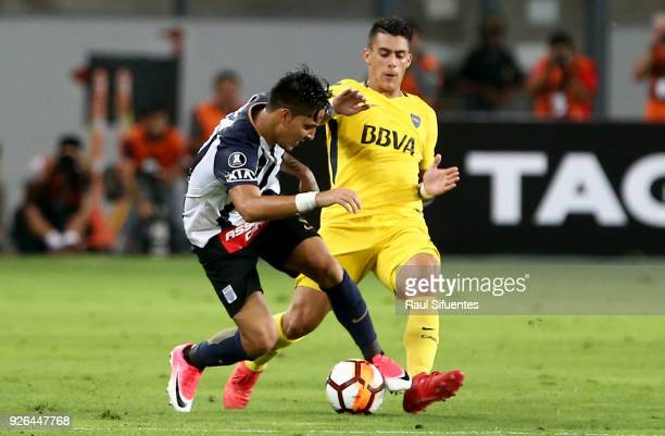 Cristian Pavon Boca Juniors struggles for the ball with Francisco Duclos of Alianza Lima during a groups stage match between Alianza Lima and Boca...