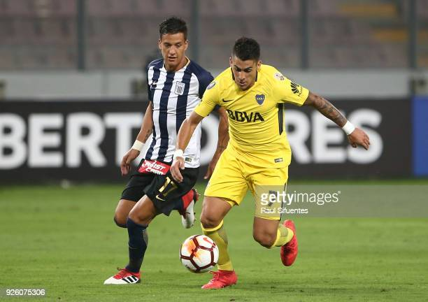 Cristian Pavon Boca Juniors struggles for the ball with Gonzalo Godoy of Alianza Lima during a groups stage match between Alianza Lima and Boca...