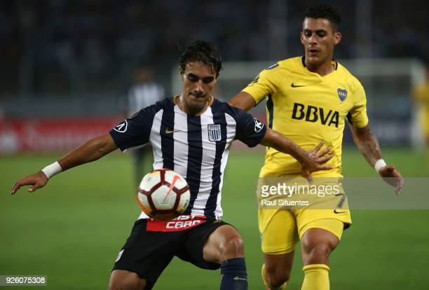 Cristian Pavon Boca Juniors struggles for the ball with Marco Garro of Alianza Lima during a groups stage match between Alianza Lima and Boca Juniors...