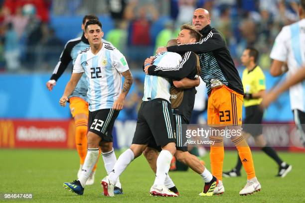 Cristian Pavon Javier Mascherano Lucas Biglia and Wilfredo Caballero of Argentina celebrate following the 2018 FIFA World Cup Russia group D match...