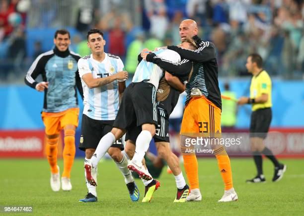 Cristian Pavon Javier Mascherano Lucas Biglia and Wilfredo Caballero of Argentina celebrate following the 2018 FIFA World Cup Russia group D match...
