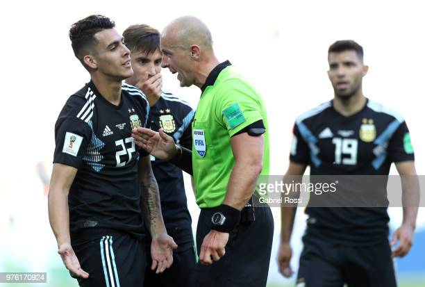 Cristian Pavon of Argentina argues with Referee Szymon Marciniak during the 2018 FIFA World Cup Russia group D match between Argentina and Iceland at...