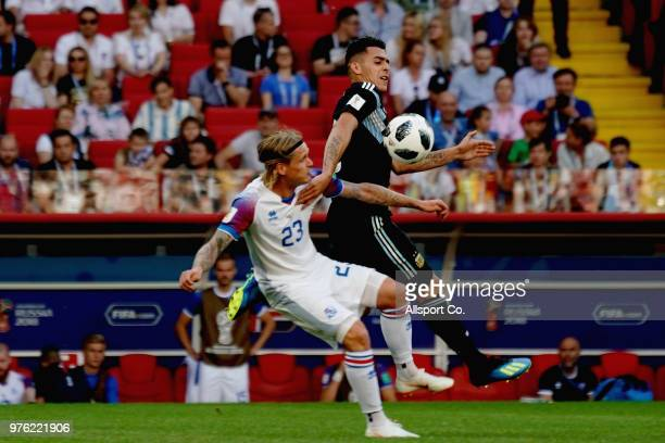 Cristian Pavon of Argentina clashes with Ari Skulason of Iceland during the 2018 FIFA World Cup Russia group D match between Argentina and Iceland at...